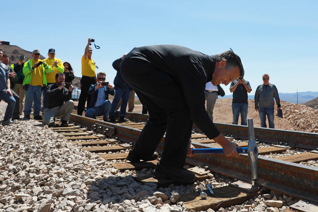 Gov. Brian Sandoval drives the final spike into a rail line that restores service between Boulder City and Henderson during an event hosted by the Nevada State Railroad Museum in Boulder City on F ...