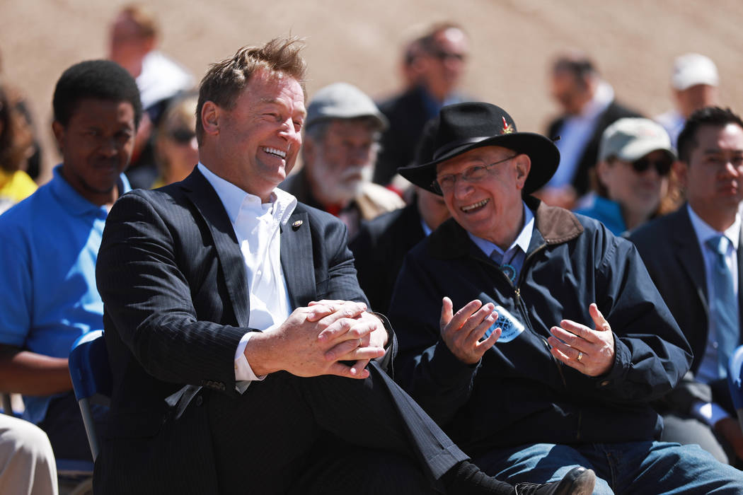 U.S. Sen. Dean Heller, R-Nev, left, talks to state Sen. Joe Hardy, R-Boulder City, during an event hosted by the Nevada State Railroad Museum in Boulder City on Friday, April 13, 2018. Andrea Corn ...