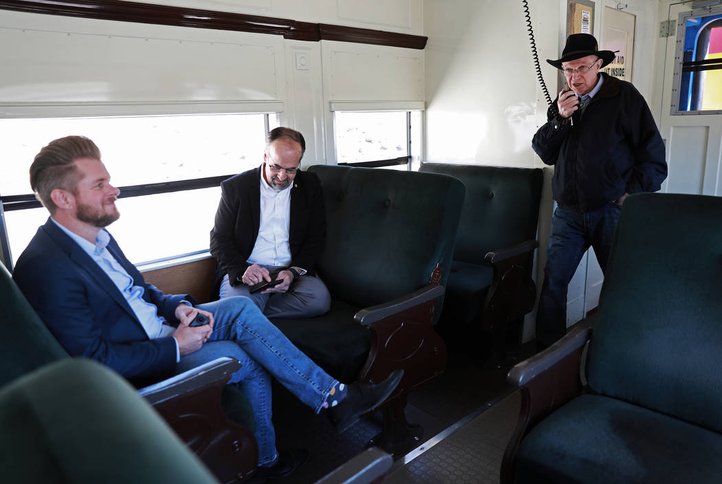 From left, John Calvert, Bret Runion and state Sen. Joe Hardy, R-Boulder City, board a train during an event hosted by the Nevada State Railroad Museum in Boulder City on Friday, April 13, 2018.  ...