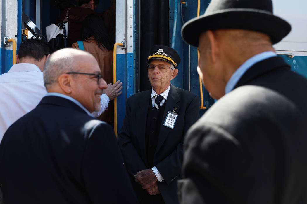 John Georgi, of the Nevada State Railroad Museum, invites attendees to board the train during an event hosted by the Nevada State Railroad Museum in Boulder City on Friday, April 13, 2018. Andrea ...