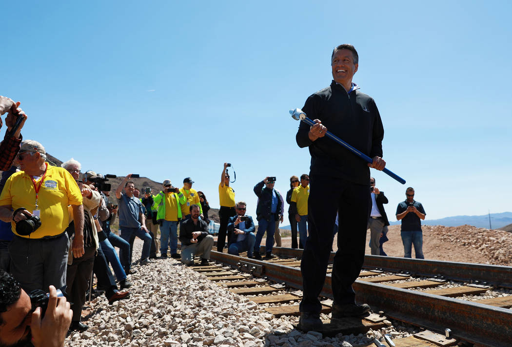 Gov. Brian Sandoval reacts after driving the final spike into a rail line that restores service between Boulder City and Henderson during an event hosted by the Nevada State Railroad Museum in Bou ...