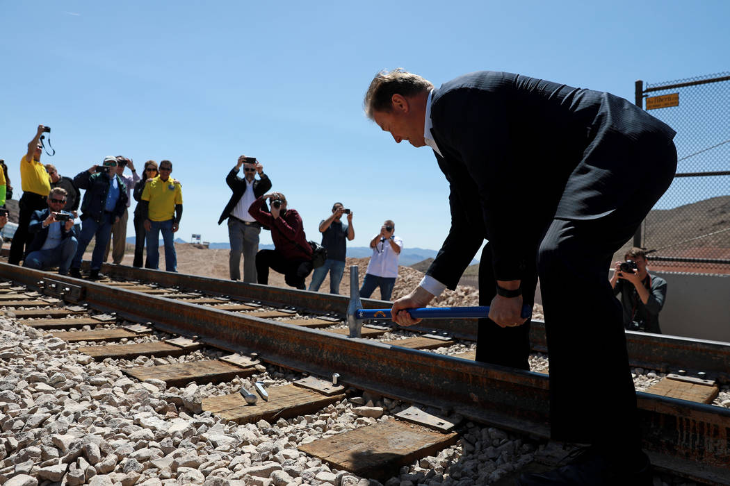U.S. Sen. Dean Heller, R-Nev, drives the final spike into a rail line that restores service between Boulder City and Henderson during an event hosted by the Nevada State Railroad Museum in Boulder ...