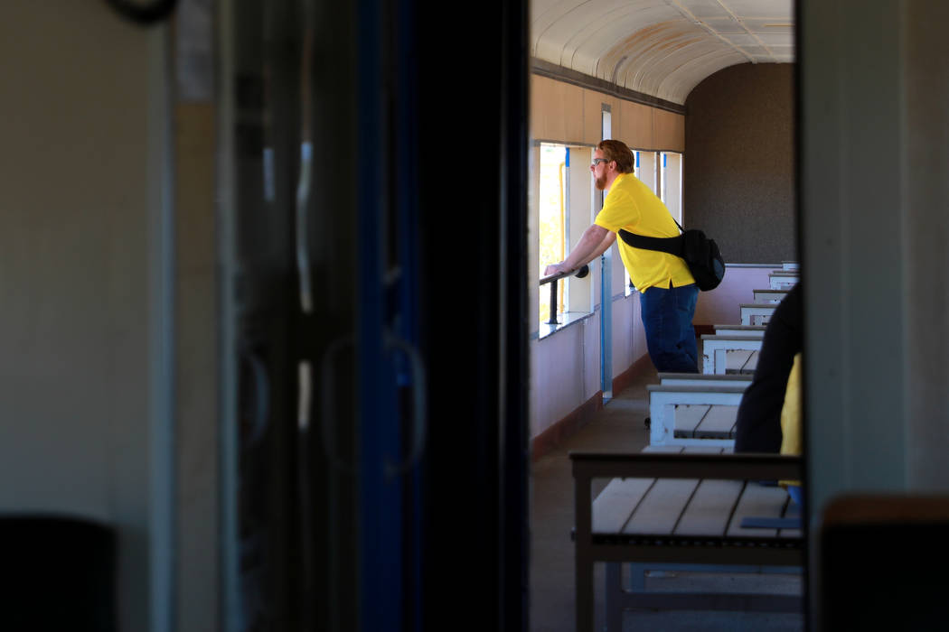 An attendee looks out of the train during an event hosted by the Nevada State Railroad Museum in Boulder City on Friday, April 13, 2018. Andrea Cornejo Las Vegas Review-Journal @dreacornejo