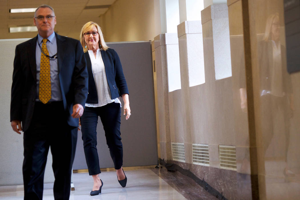 Janice Baker-Kinney, right, walks towards the courtroom to testify during Bill Cosby's sexual assault retrial in the Montgomery County Courthouse on Thursday, April 12, 2018, in Norristown, Pa. (M ...