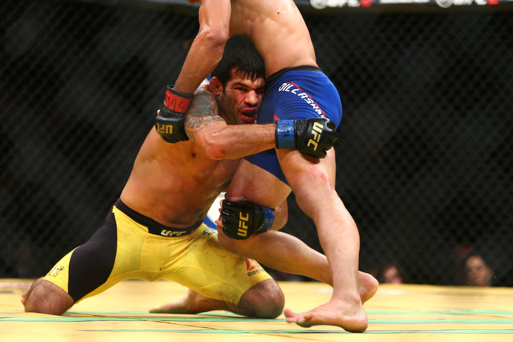 Raphael Assuncao grapples with TJ Dillashaw during their bantamweight fight at UFC 200 at T-Mobile Arena in Las Vegas on Saturday, July 9, 2016. Loren Townsley/Las Vegas Review-Journal Follow @lor ...