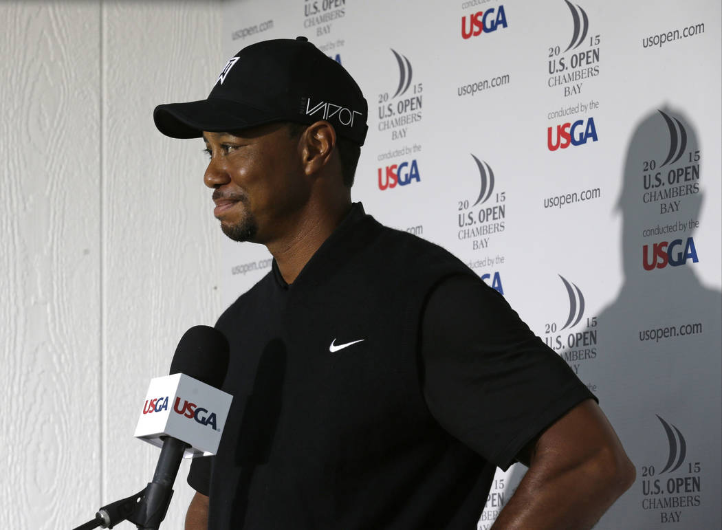 In this June 18, 2015, file photo, Tiger Woods speaks to the media during a news conference after shooting a 10 over-par 80 in the first round of the U.S. Open golf tournament at Chambers Bay in U ...
