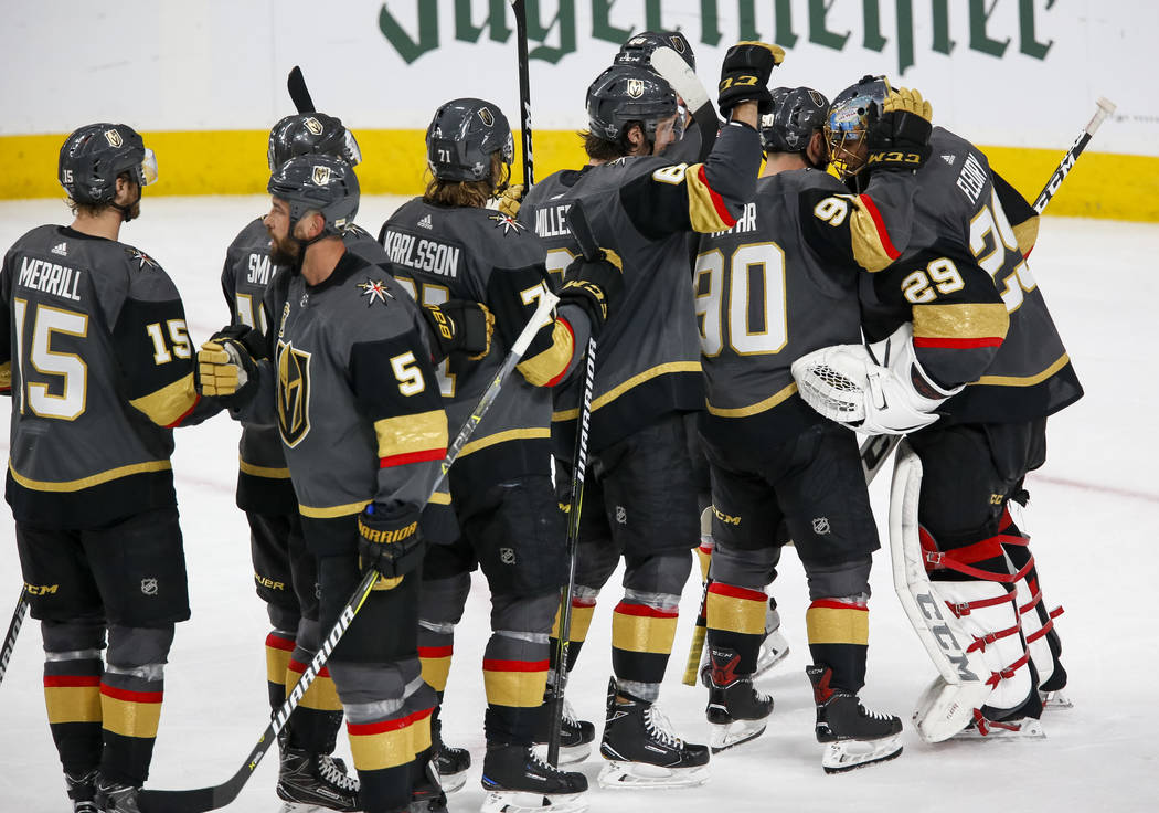 Golden Knights players congratulate goaltender Marc-Andre Fleury (29) following Game 1 of an NHL hockey first-round playoff series between the Golden Knights and the Los Angeles Kings at T-Mobile ...