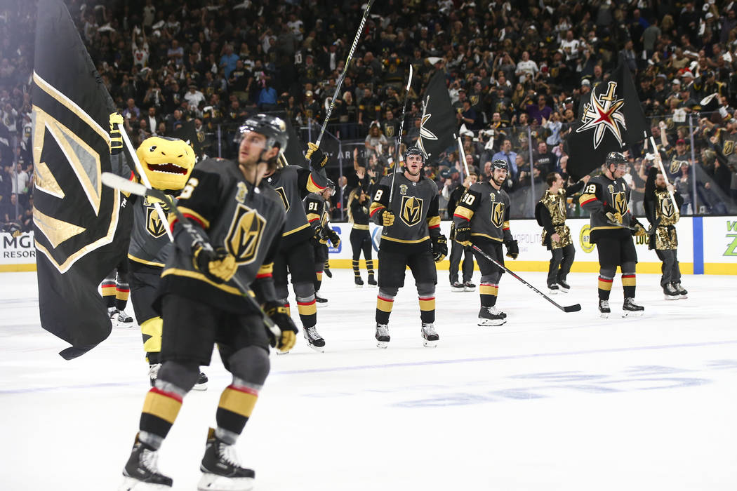 Golden Knights players celebrate their defeat over the Los Angeles Kings in Game 1 of an NHL hockey first-round playoff series at T-Mobile Arena in Las Vegas on Wednesday, April 11, 2018. Chase St ...