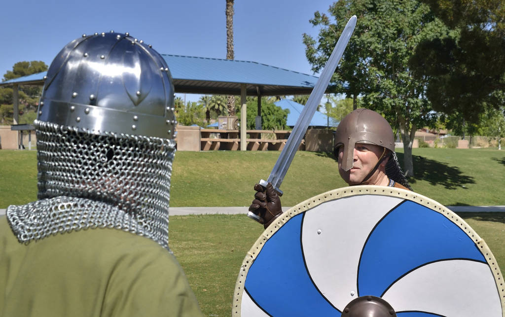 """Erik Pappa, left, and Rick Mikkelsen engage in a sword fight during a demonstration of """"How to Fight Like a Viking"""" sponsored by the Sons of Norway Vegas Vikings Lodge 6-152 at Loren ..."""