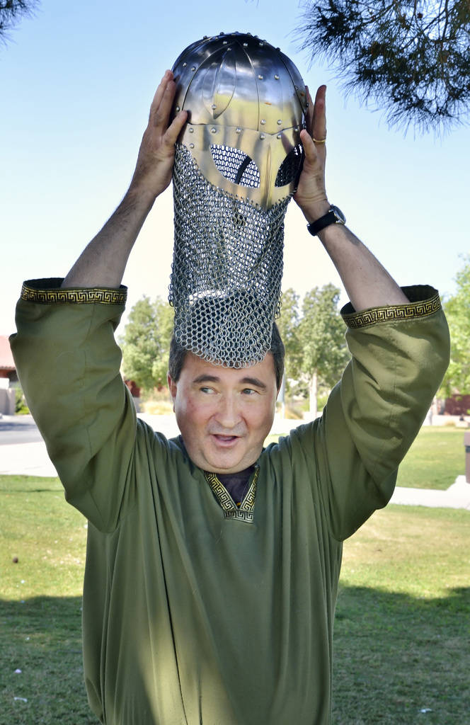 """Erik Pappa dons a helmet during a demonstration of """"How to Fight Like a Viking"""" sponsored by the Sons of Norway Vegas Vikings Lodge 6-152 at Lorenzi Park at 3343 W. Washington Ave. i ..."""