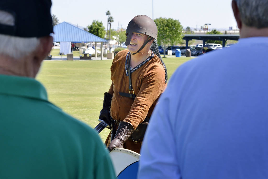 """Rick Mikkelsen, center, talks with attendees at a demonstration of """"How to Fight Like a Viking"""" sponsored by the Sons of Norway Vegas Vikings Lodge 6-152 at Lorenzi Park at 3343 W. W ..."""