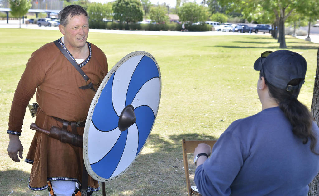 """Rick Mikkelsen, left, talks with Nivia Balsera during a demonstration of """"How to Fight Like a Viking"""" sponsored by the Sons of Norway Vegas Vikings Lodge 6-152 at Lorenzi Park at 334 ..."""
