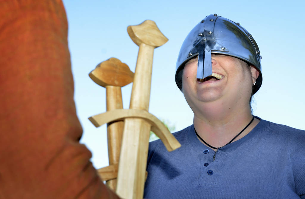 """Nivia Balsera tries on a helmet during a demonstration of """"How to Fight Like a Viking"""" sponsored by the Sons of Norway Vegas Vikings Lodge 6-152 at Lorenzi Park at 3343 W. Washington ..."""