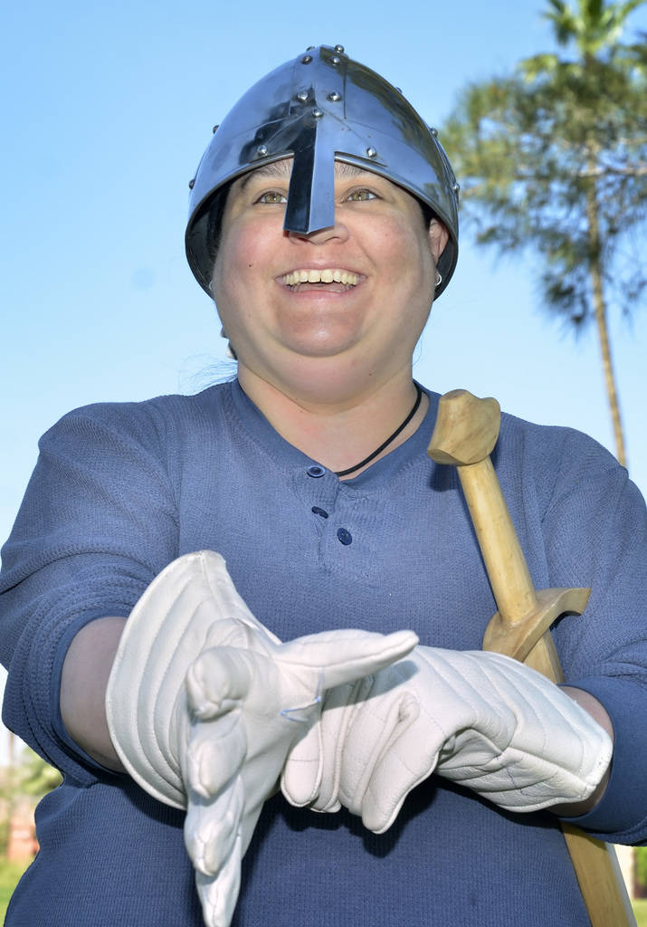 """Nivia Balsera pulls on some gloves before participating in a demonstration of """"How to Fight Like a Viking"""" sponsored by the Sons of Norway Vegas Vikings Lodge 6-152 at Lorenzi Park a ..."""