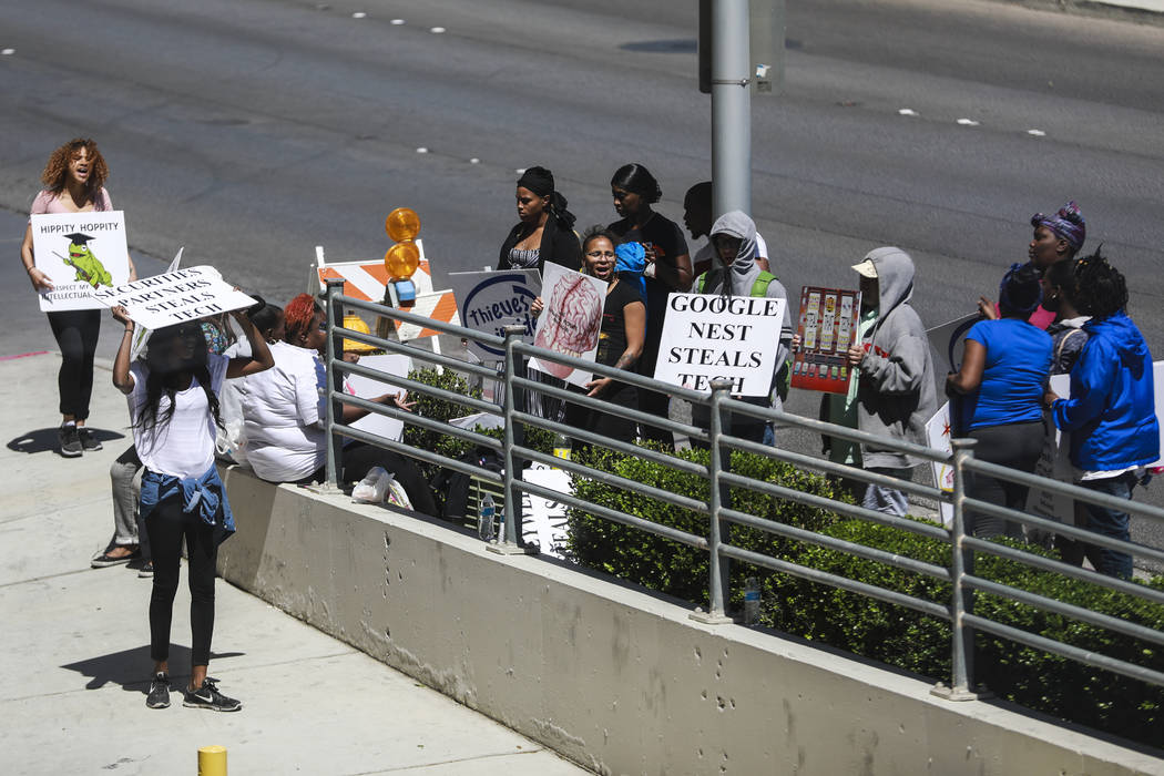 Protestors stand outside of the International Security Conference & Exposition, also known as ISC West, at the Sands Expo and Convention Center in Las Vegas on Thursday, April 12, 2018. ISC We ...
