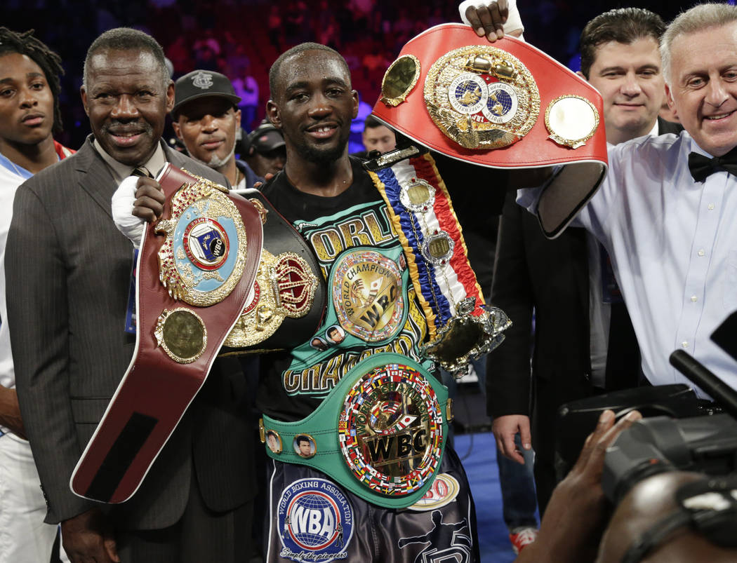 "CORRECTS TO THIRD ROUND, INSTEAD OF SECOND - Terence ""Bud"" Crawford celebrates his victory by knockout over Julius Indongo in the third round of a junior welterweight world title unific ..."
