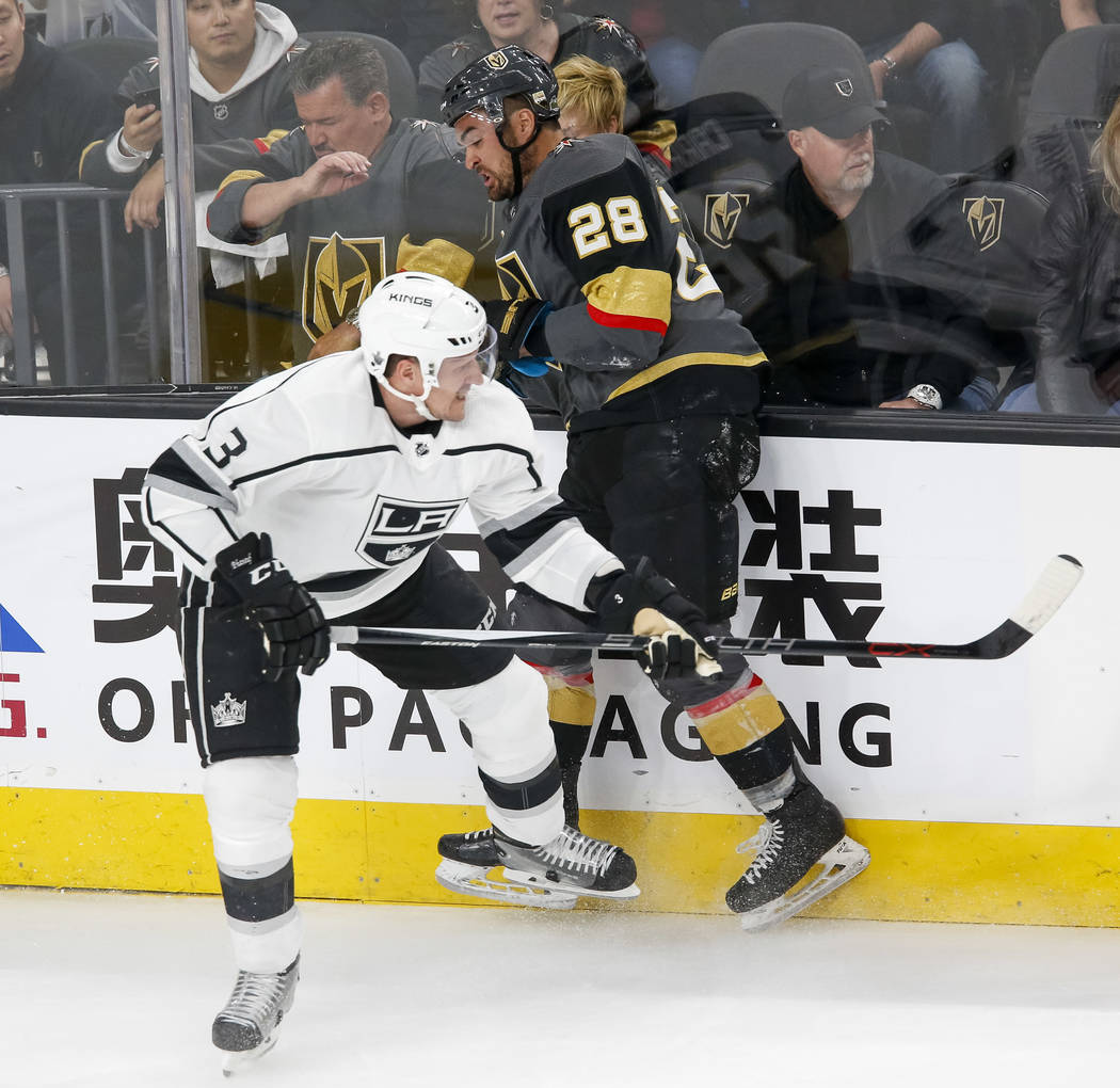 Los Angeles Kings defenseman Dion Phaneuf (3) collides with Golden Knights left wing William Carrier (28) during the first period of Game 1 of an NHL hockey first-round playoff series between the ...