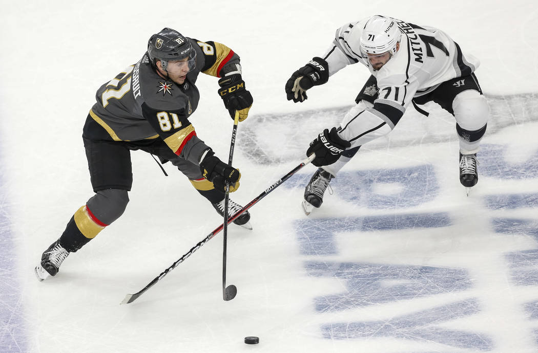 Golden Knights center Jonathan Marchessault (81) takes a shot as Los Angeles Kings center Torrey Mitchell (71) defends during the second period of Game 1 of an NHL hockey first-round playoff serie ...