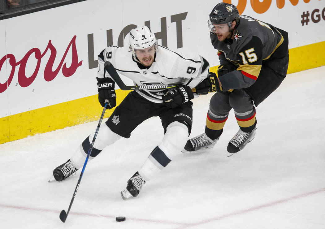 Los Angeles Kings left wing Adrian Kempe (9) carries the puck as Golden Knights defenseman Jon Merrill (15) follows behind during the second period of Game 1 of an NHL hockey first-round playoff s ...