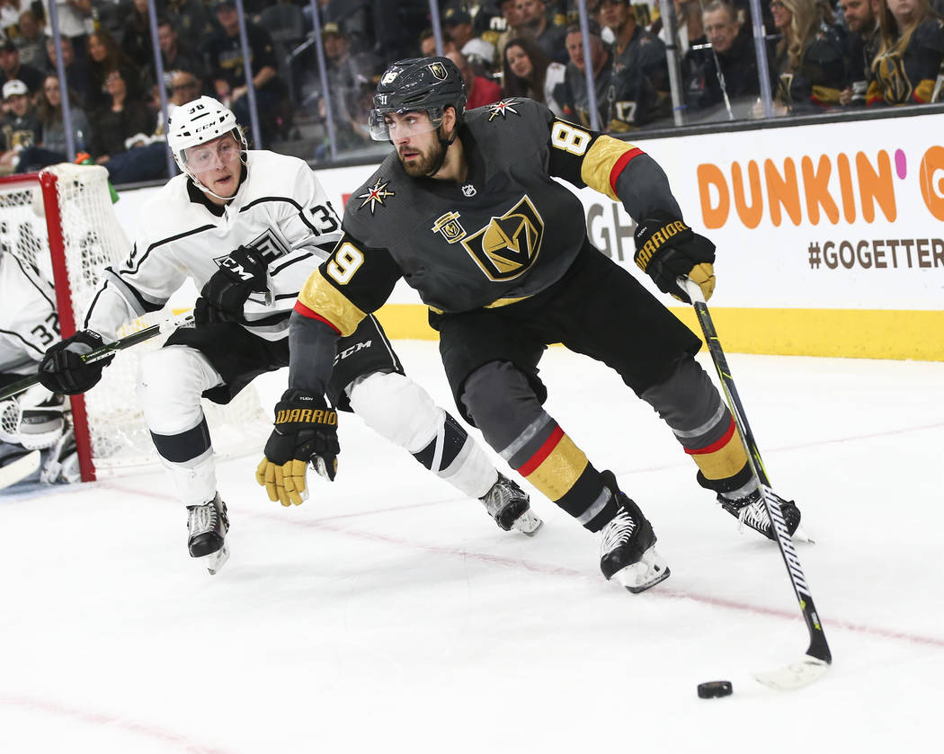 Golden Knights right wing Alex Tuch (89) moves the puck around Los Angeles Kings defenseman Paul LaDue (38) during the third period of Game 1 of an NHL hockey first-round playoff series at T-Mobil ...