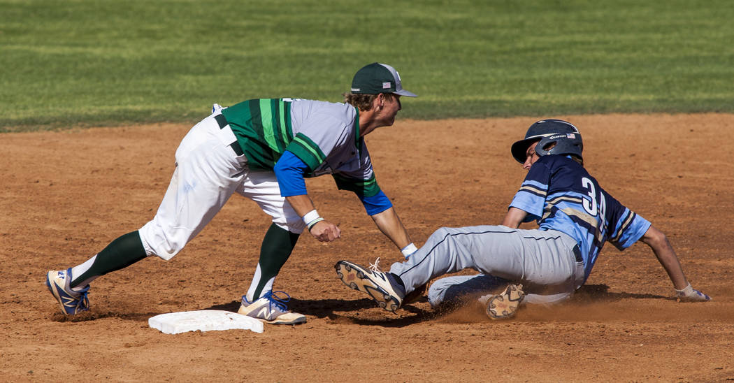 Green Valley's infielder Carter Gehlken tags out Foothill's Kelton Lachelt at second base during the third inning at Green Valley High School on Thursday, April 12, 2018. Green Valley won 5-3. Pa ...