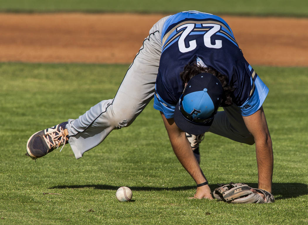 Foothill infielder Chris Ranieri tries to grab the ball but misses while playing against Green Valley during the fifth inning at Green Valley High School on Thursday, April 12, 2018. Green Valley ...