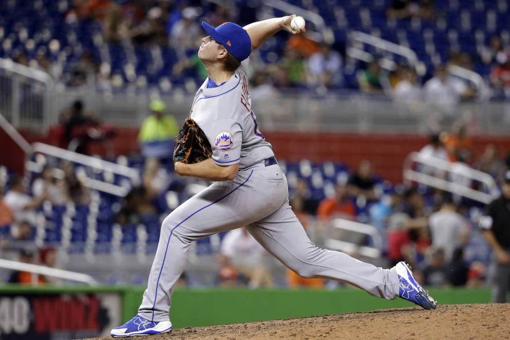 New York Mets starting pitcher Chris Flexen delivers during a baseball game against the Miami Marlins, Monday, Sept. 18, 2017, in Miami. The Marlins won 13-1. (AP Photo/Lynne Sladky)