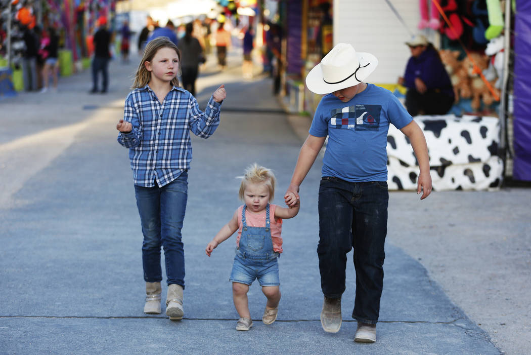 From left, Sidney, Riley and Hudson walk around the Clark County Fair & Rodeo in Logandale, Nevada on Thursday, April 12, 2018. Andrea Cornejo Las Vegas Review-Journal @dreacornejo