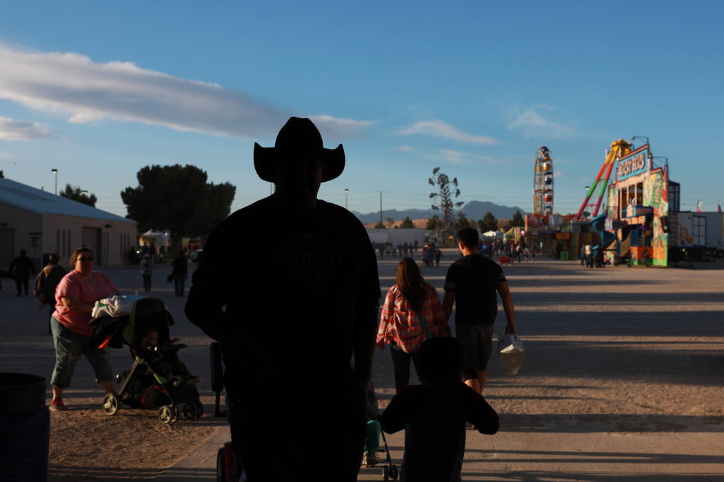 Attendees walk around the Clark County Fair & Rodeo in Logandale, Nevada on Thursday, April 12, 2018. Andrea Cornejo Las Vegas Review-Journal @dreacornejo