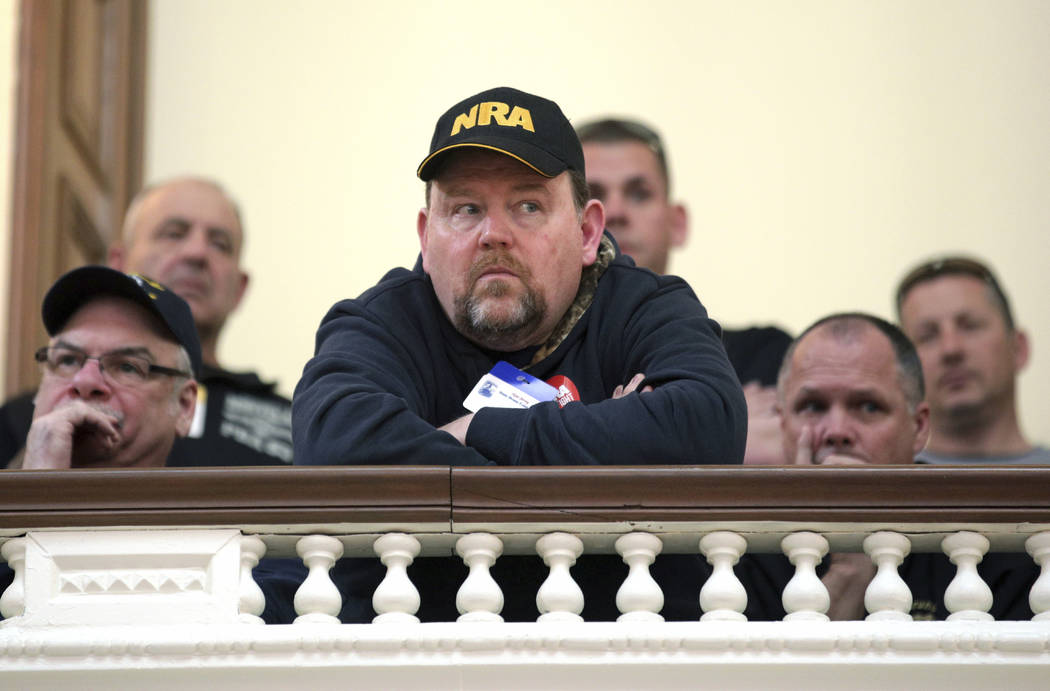Men listen in the gallery as the New Jersey Assembly considers and votes on a half-dozen gun control bills Monday, March 26, 2018, in the Statehouse in Trenton, N.J. New Jersey's Democrat-led Asse ...
