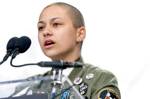 FILE -- In this March 24, 2018 file photo, Emma Gonzalez, a survivor of the mass shooting at Marjory Stoneman Douglas High School in Parkland, Fla., closes her eyes and cries as she stands silentl ...