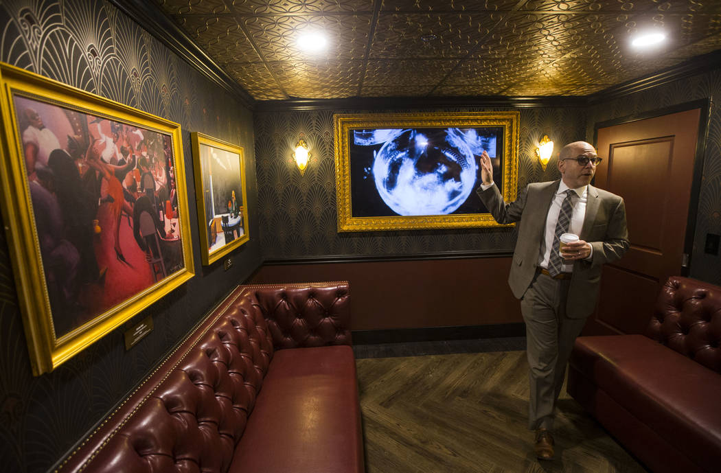 Jonathan Ullman, president and chief executive officer of The Mob Museum, talks about the prohibition-era paintings by artists such as Edward Hopper and John French Sloan on display in a hidden ro ...