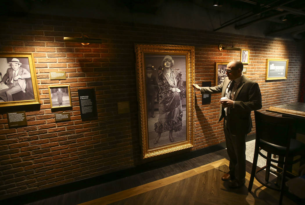 Jonathan Ullman, president and chief executive officer of The Mob Museum, shows off the entrance to a room hidden by a wall-length portrait in the speakeasy at The Underground at The Mob Museum in ...