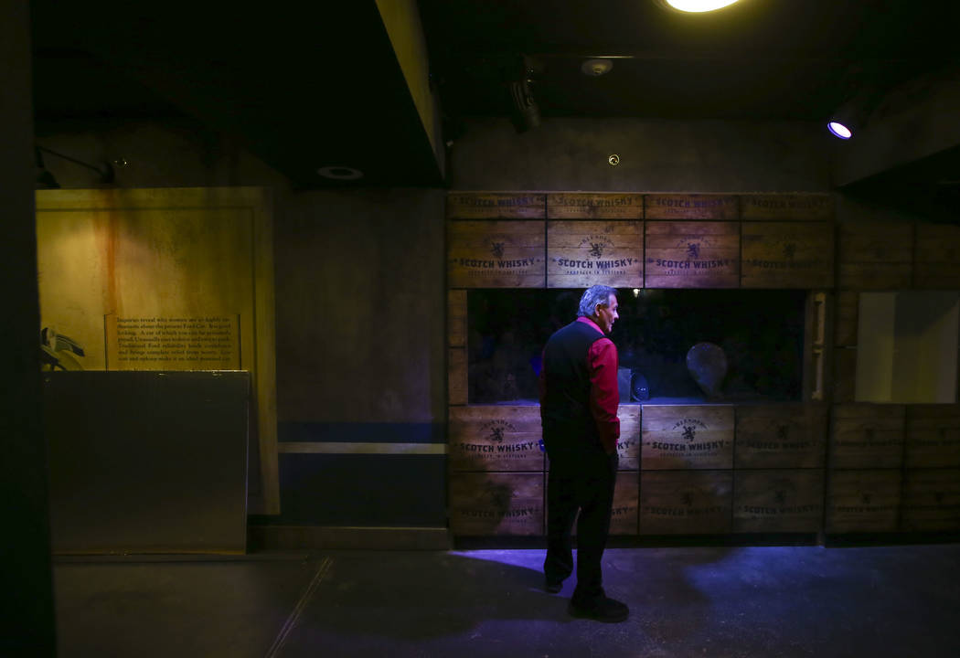 An employee takes a look as final touches are made at The Underground at The Mob Museum in downtown Las Vegas on Saturday, April 14, 2018. The basement-level exhibition of the Prohibition era feat ...