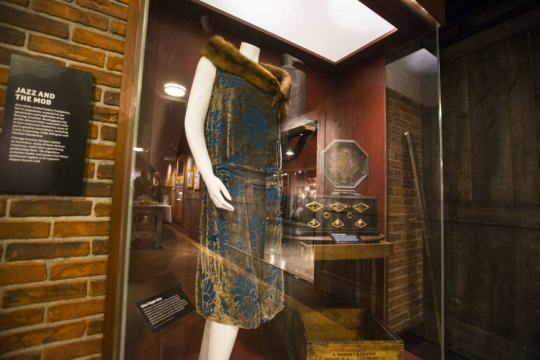 A velvet flapper dress with a mink fur scarf on display in the speakeasy at The Underground at The Mob Museum in downtown Las Vegas on Saturday, April 14, 2018. The basement-level exhibition of th ...