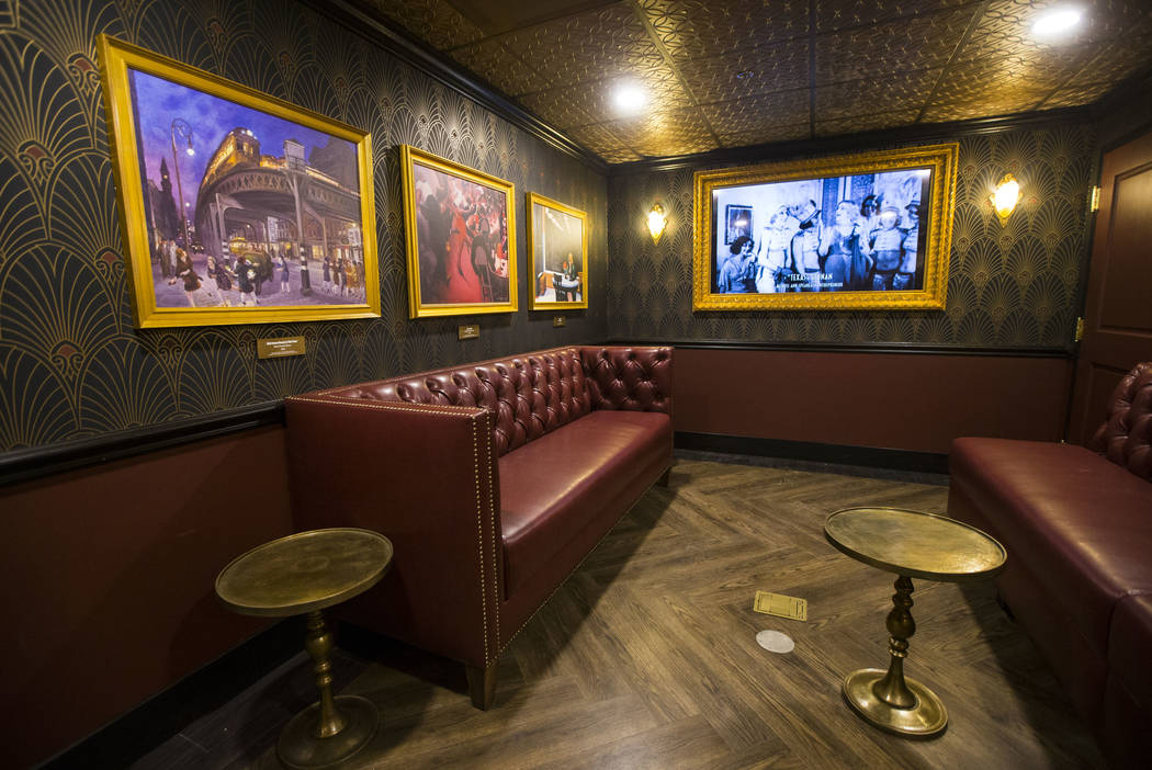 A room hidden by a wall-length portrait in the speakeasy features 1920s artwork at The Underground at The Mob Museum in downtown Las Vegas on Saturday, April 14, 2018. The basement-level exhibitio ...