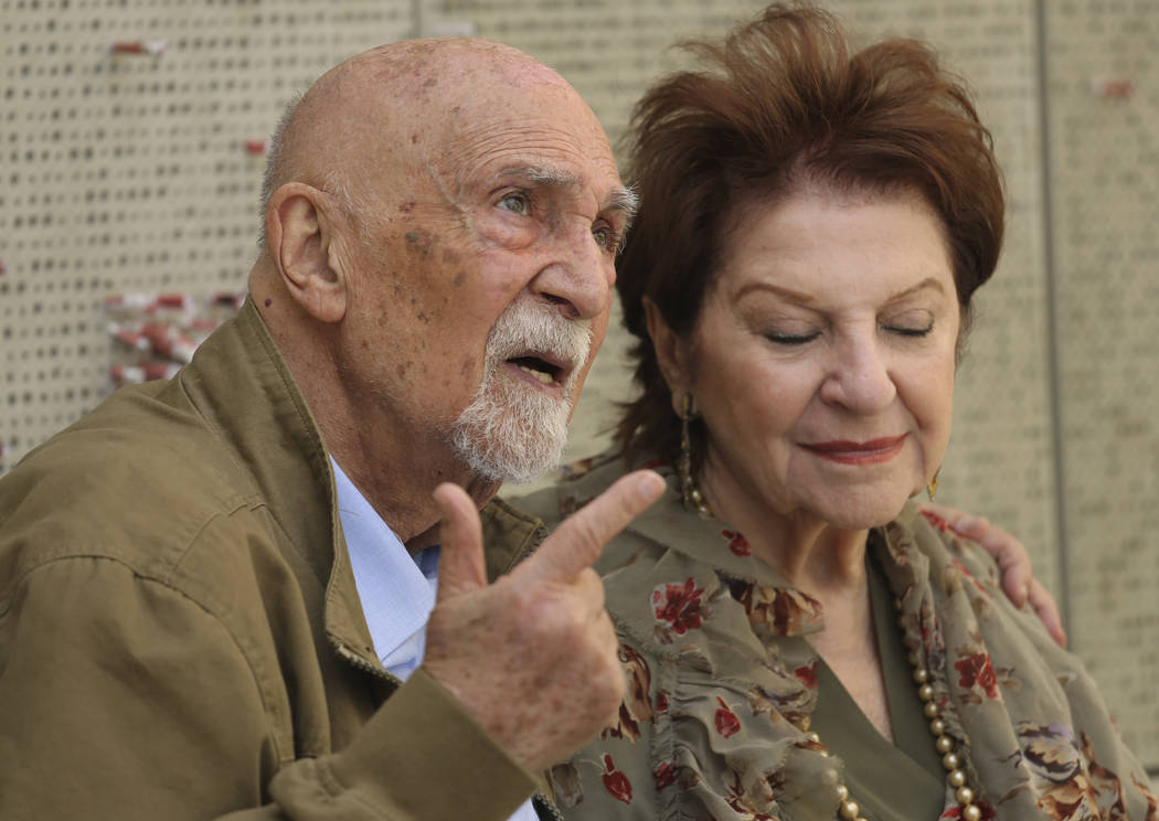 In this Wednesday, April 11, 2018, photo, childhood Holocaust survivors Simon Gronowski and Alice Gerstel Weit are interviewed at the Los Angeles Holocaust Museum memorial after their reunion afte ...