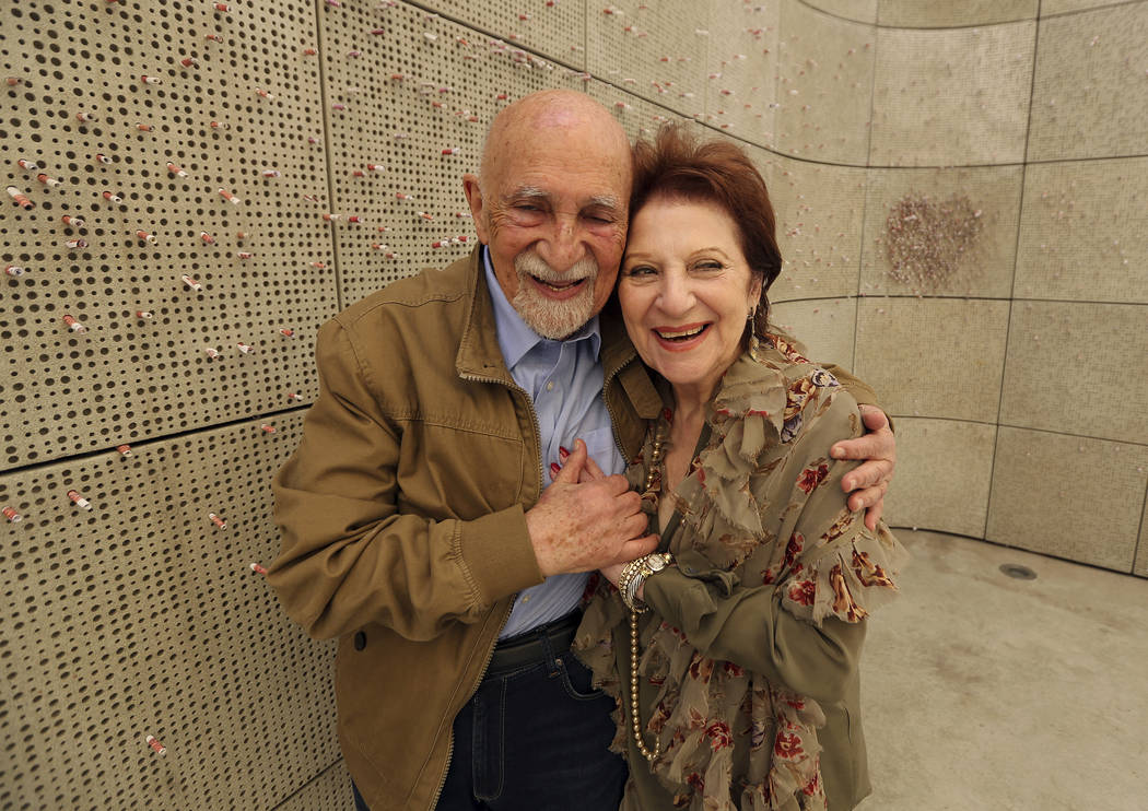 In this Wednesday, April 11, 2018, photo, childhood Holocaust survivors Simon Gronowski and Alice Gerstel Weit hug at the Los Angeles Holocaust Museum memorial. There was much hugging, kissing and ...