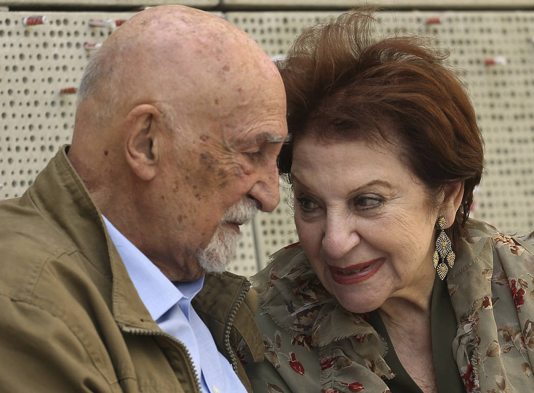 In this Wednesday, April 11, 2018, photo, childhood Holocaust survivors Simon Gronowski and Alice Gerstel Weit talk as they are interviewed at the Los Angeles Holocaust Museum, after their reunion ...