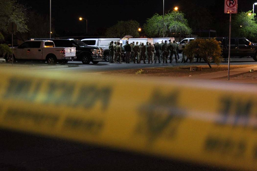 Metro SWAT officers helped end a standoff in the southeast valley Friday morning. A man was taken into custody and a woman and child were released unharmed. (Max Michor/Las Vegas Review-Journal