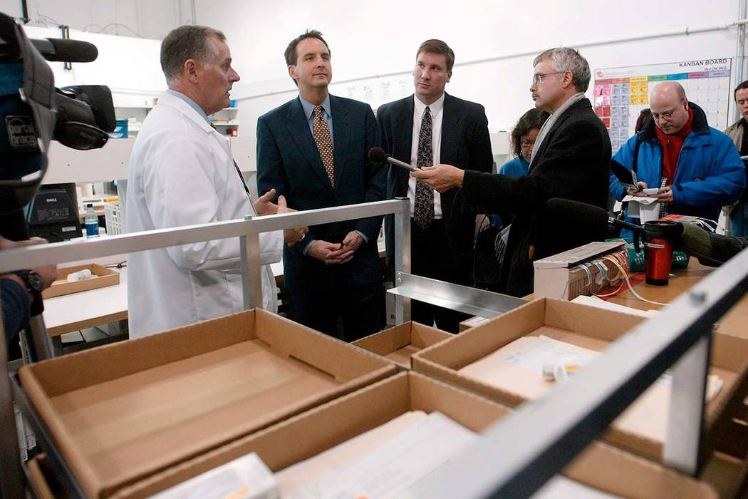 n this Nov. 12, 2003, file photo, CanadaDrugs.com Director of Pharmacy Robert Fraser, left, takes Minnesota Gov. Tim Pawlenty, second left, on a tour of the Internet pharmacy CanadaDrugs.com in Wi ...