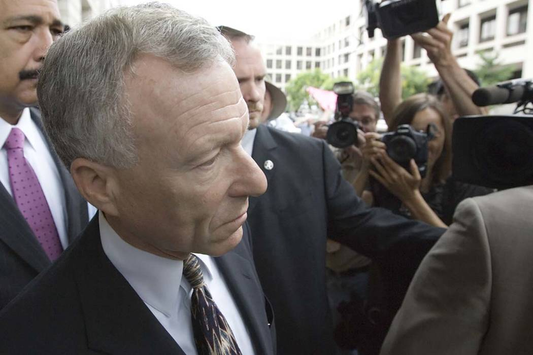 "Former White House aide I. Lewis ""Scooter"" Libby walks toward his car outside federal court in Washington, Tuesday, June 5, 2007, after he was sentenced to 2 1/2 years in prison for lying and obst ..."