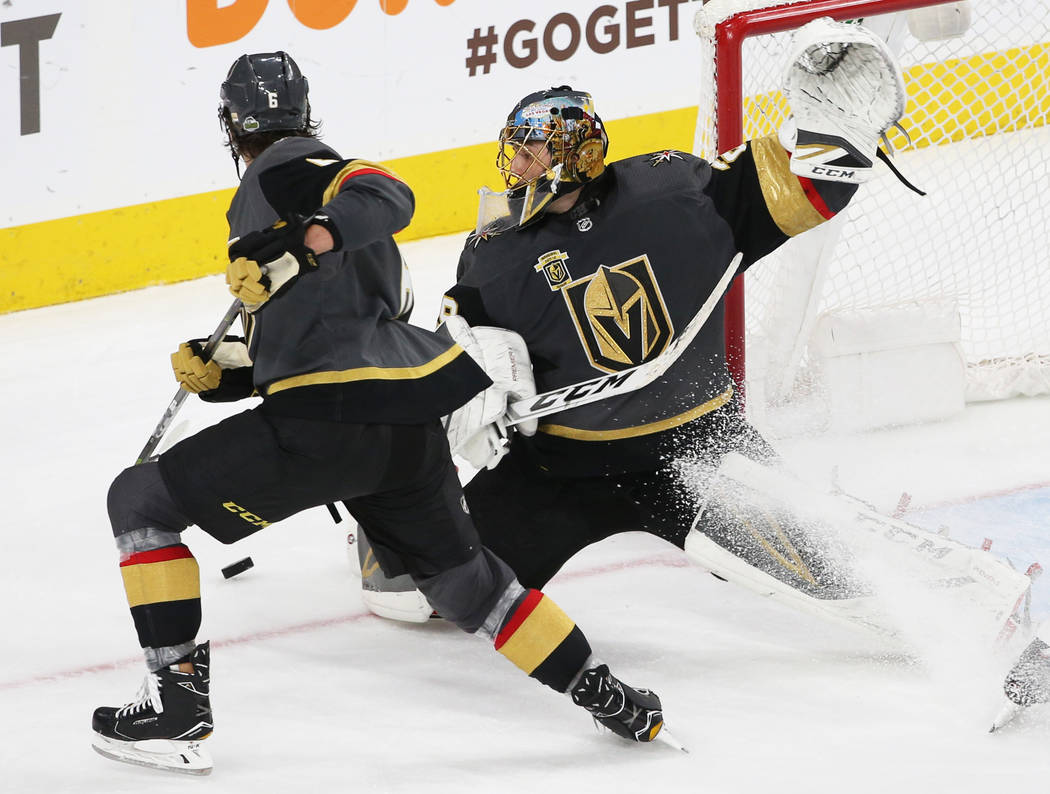 Golden Knights goaltender Marc-Andre Fleury (29) makes a save against during the first overtime period of game two of their first-round playoff series on Friday, April 13, 2018, at T-Mobile Arena, ...