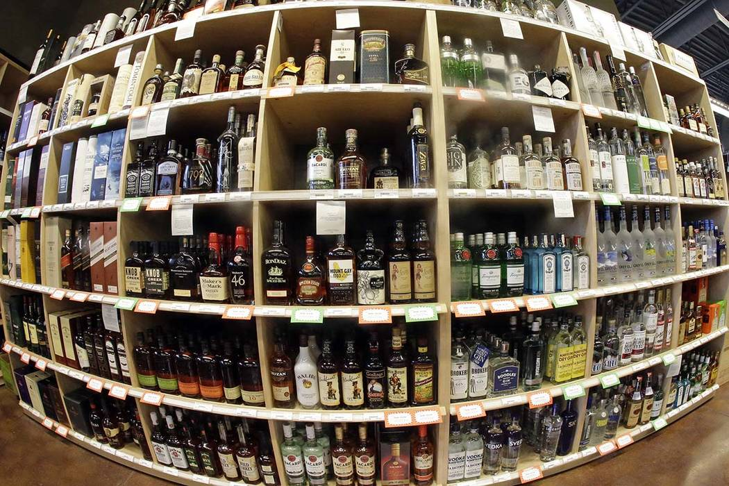 This June 16, 2016 file photo made with a fisheye lens shows bottles of alcohol during a tour of a state liquor store in Salt Lake City. A large international study released on Thursday, April 12, ...