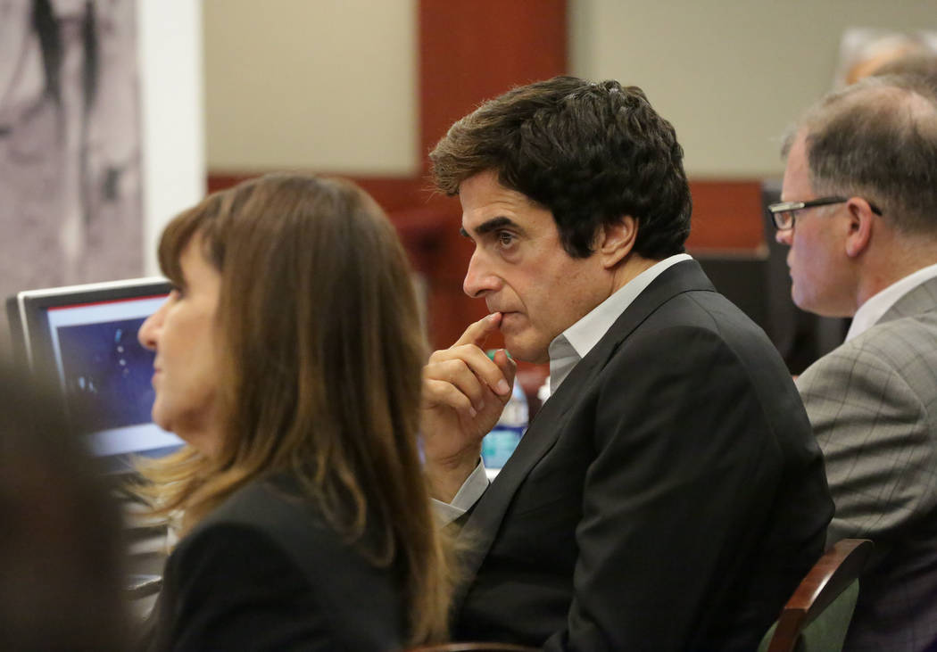 Illusionist David Copperfield, center, looks on during opening statements in a civil trial at the Regional Justice Center in Las Vegas on Friday, April 13, 2018. (Michael Quine/Las Vegas Review-Jo ...