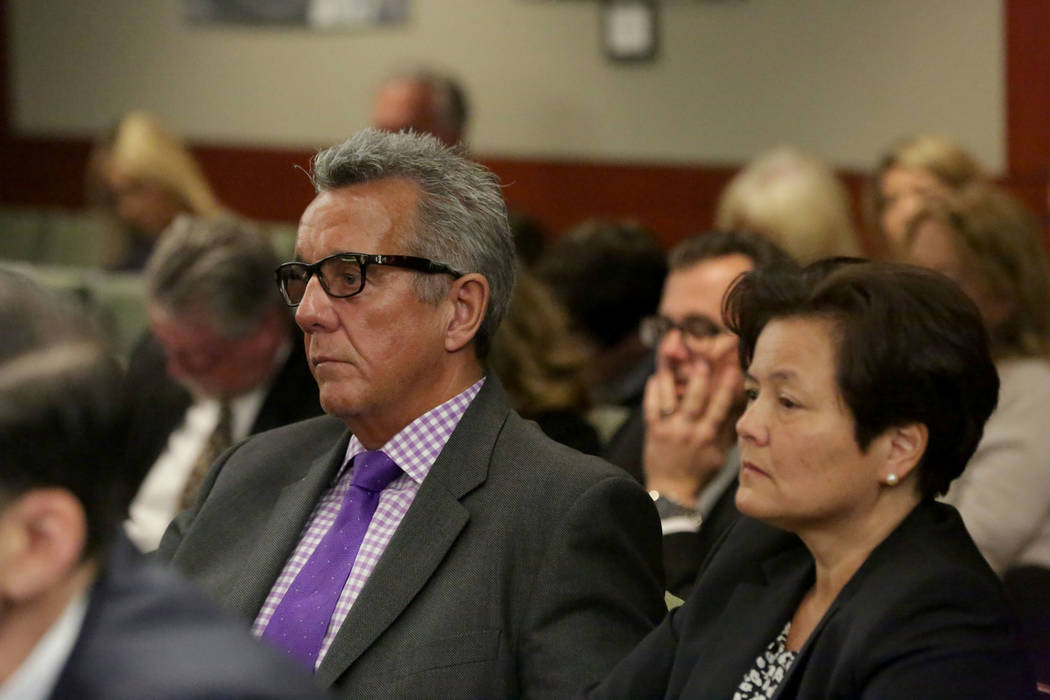 Gavin Cox, left, who was injured during an illusion by David Copperfield at the MGM, sits with his wife Minh-Hahn Cox during opening statements of his suit against Coperfield and the MGM Grand on& ...