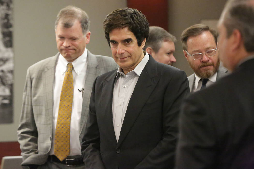 Illusionist David Copperfield, center, appears at the Regional Justice Center in Las Vegas before opening statements in a civil trial on Friday, April 13, 2018. (Michael Quine/Las Vegas Review-Jou ...