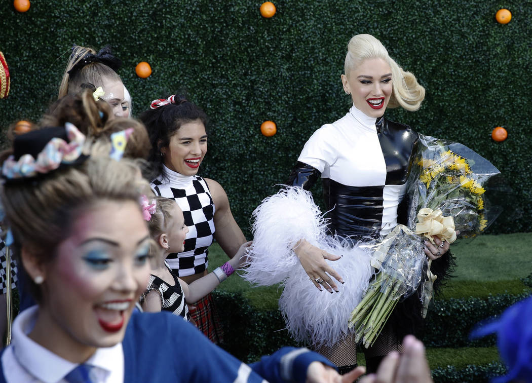 "Gwen Stefani, right, arrives at an event at Planet Hollywood hotel-casino on Friday, April 13, 2018, in Las Vegas. Stefani announced her ""Just a Girl"" residency at Zappos Theater beginni ..."