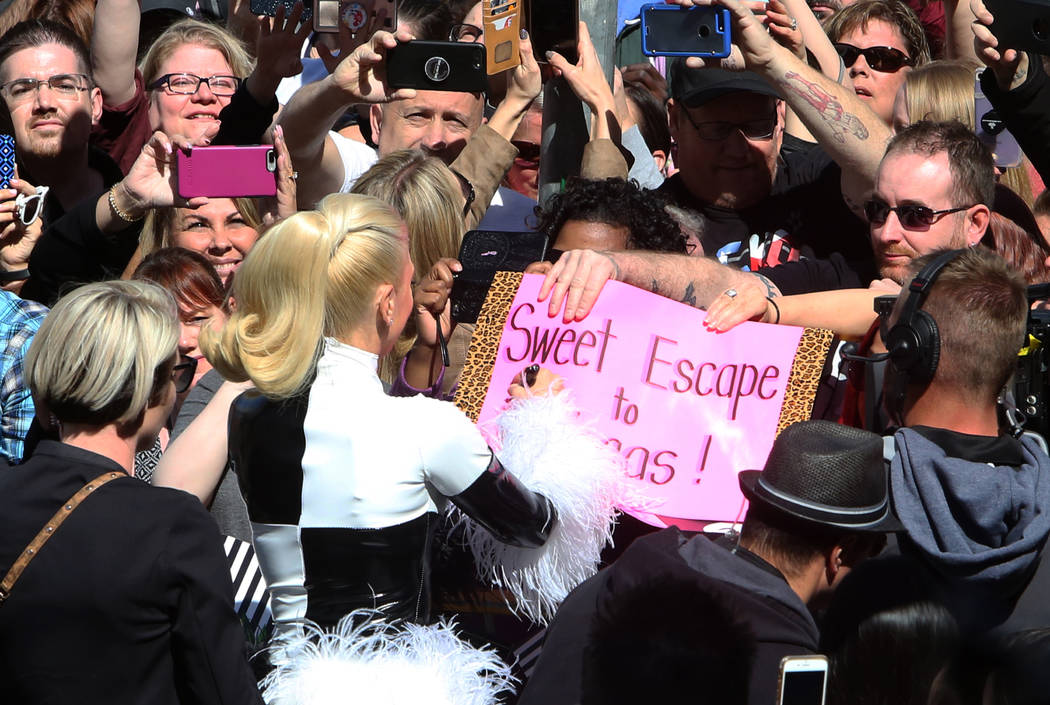 "Gwen Stefani signs autographs after arriving to at an event at Planet Hollywood hotel-casino on Friday, April 13, 2018, in Las Vegas. Stefani announced her ""Just a Girl"" residency at Zap ..."