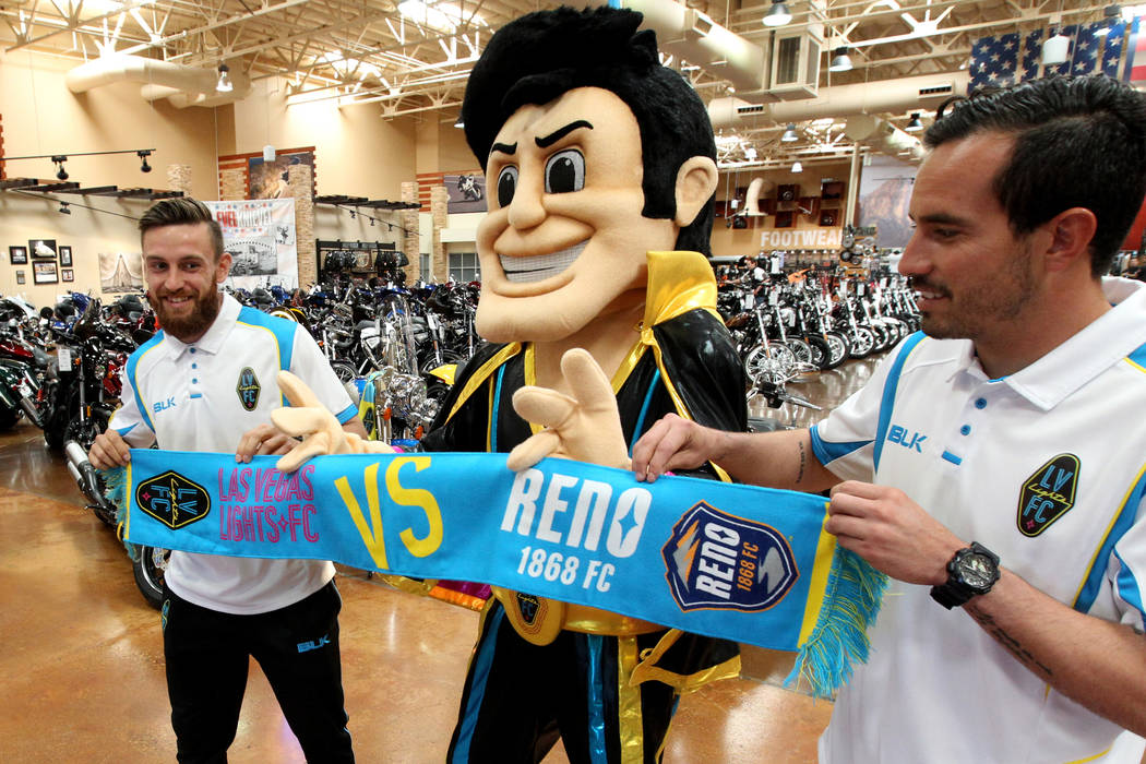 Cash the Soccer Rocker, Lights FC defender Zak Drake, left, and goalkeeper Ricardo Ferrino, promote the team's rivalry game against Reno during Cash's promotional introduction at Red Rock Harley-D ...